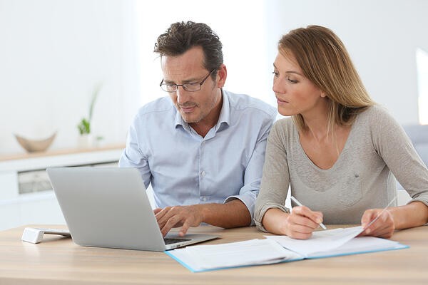 Couple at home working on laptop computer-1